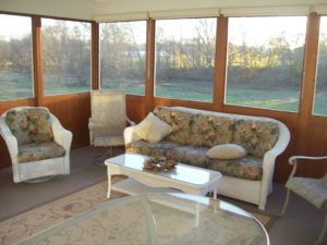 furnished screened in sunroom