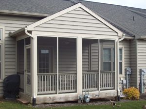 screened in porch attached to home