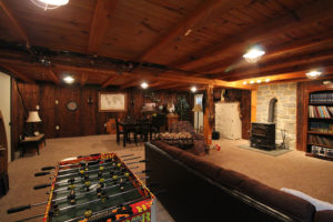 newly renovated basement with wood accents