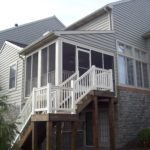 custom screened in porch with white vinyl staircase