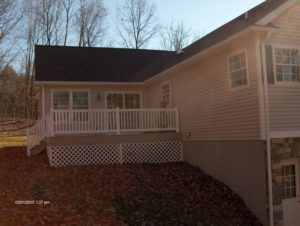 side view of attached deck and addition