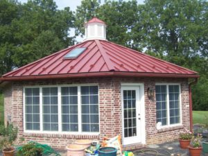 red gutter and downspout on home addition