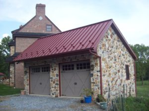 red metal roof and downspout on custom garage