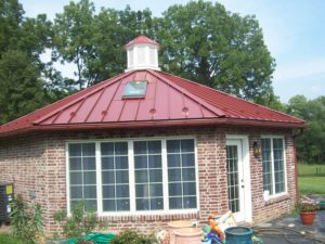 red metal roof and gutters