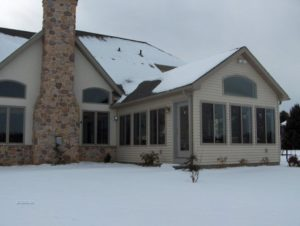 attached home addition in the snow