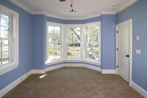interior blue bedroom remodel with large windows