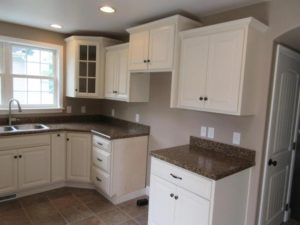 kitchen remodel with white cabinets and wood floor