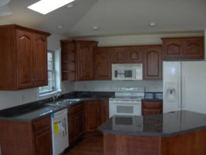 newly renovated kitchen with wooden cabinets
