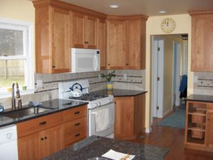 newly remodeled kitchen with wood cabinets