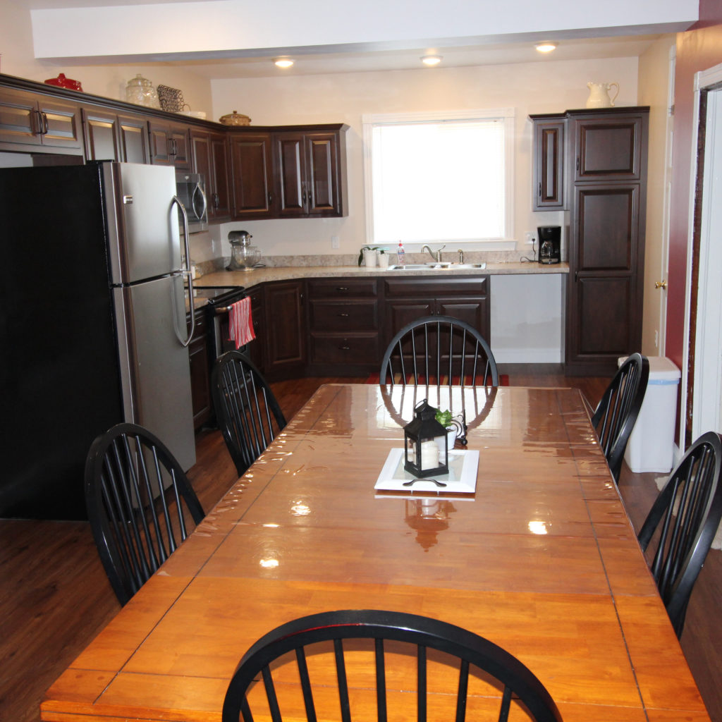 new kitchen with wood floors and dark wooden cabinets