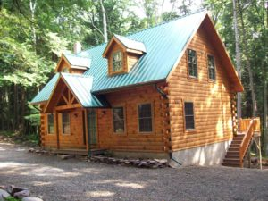 newly built log cabin with metal roof