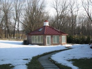 detached sunroom addition with metal roof