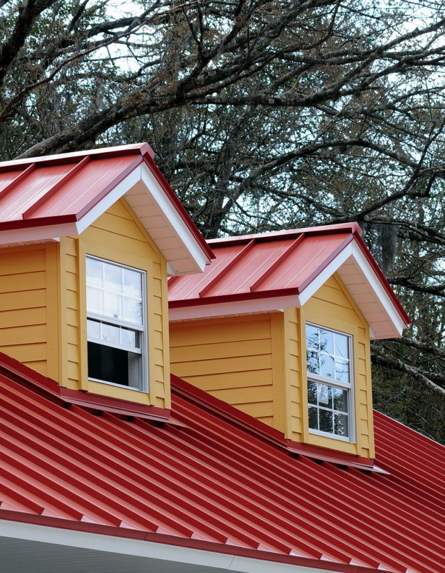new red metal roof on cape code style home