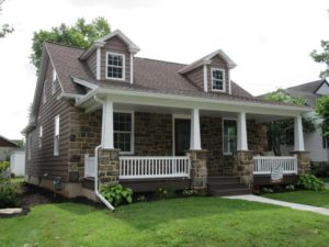cape cod stone and vinyl sided home
