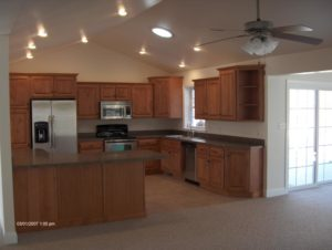 new kitchen with wood cabinet and faux wood floor