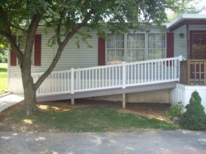 white ramp leading to home addition