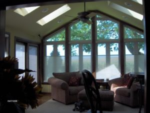 furnished sunroom with fan