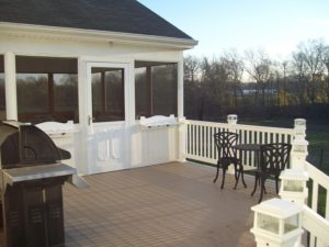 custom deck attached to screened in sunroom