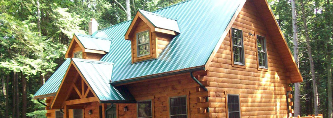 green metal roof on wood cabin in pa