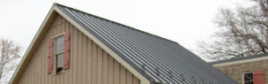 side view of gray metal roof on home