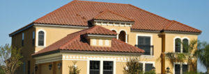 red stucco roof on large home