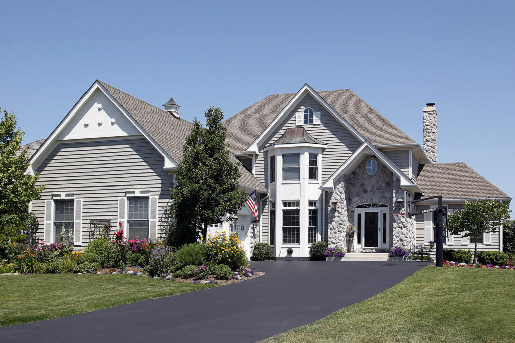 gray composite siding on large residential home